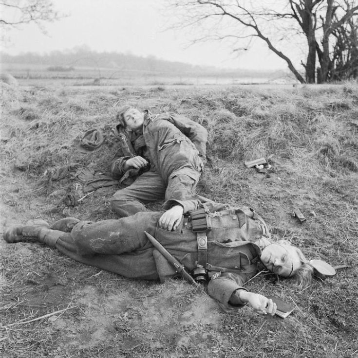 Two German soldiers, one dead and the other seriously wounded, are photographed by Allied forces during Operation Plunder, the crossing of the Rhine River and south of the Lippe River, advancing into Germany. Near Rees, North Rhine-Westphalia, Germany. 26 March 1945.