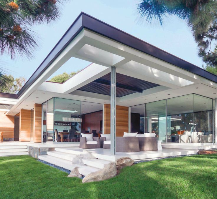 Modern Home with floor to ceiling glass windows and outside seating area