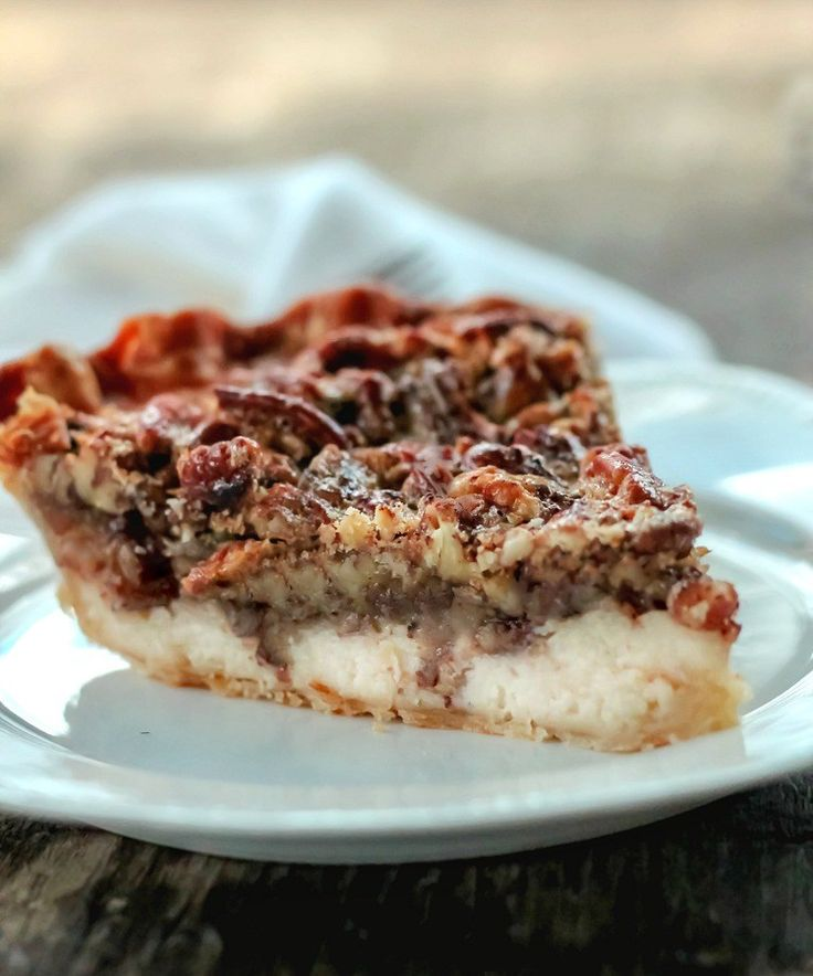 Pecan cream cheese pie with a cheese cake filling layer