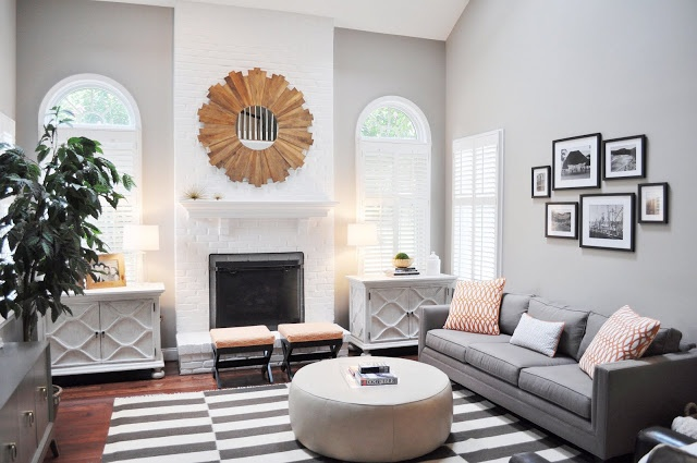 Family room with grey walls a grey and white striped rug - Family pictures on living room wall ...