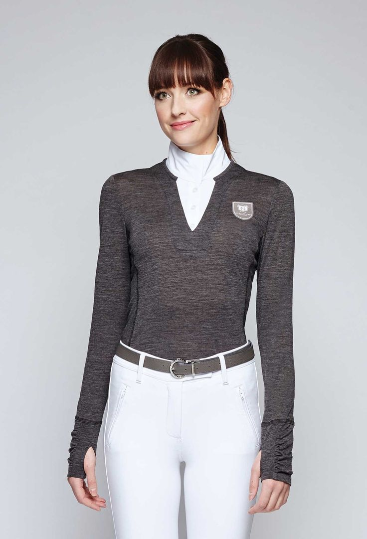 The Delta Merino Sweater from Noel Asmar is a unique hybrid that creates a single layer silhouette that instantly elevates any equestrian look. Perfect for fall in Charcoal, Black, or Twilight.