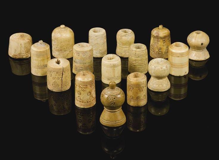 Sixteen ivory and bone chess and other gaming pieces, Persia or Egypt, 9th-11th century