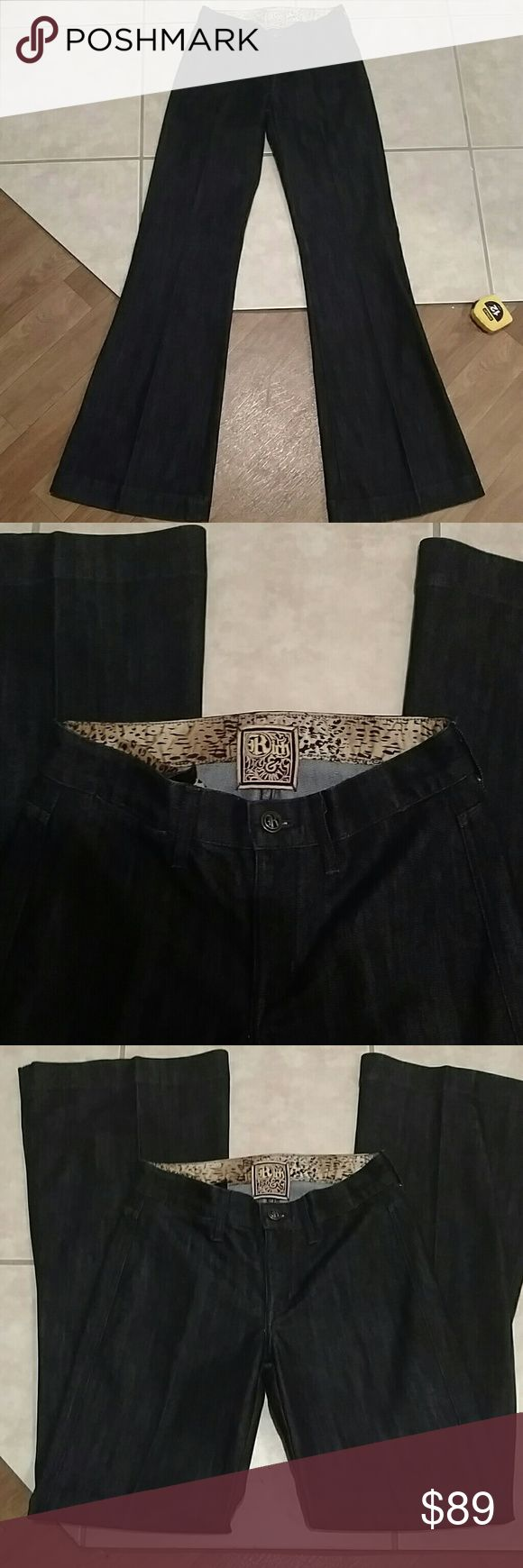 Rich & Skinny jeans NWOT and free purse Beautiful midnight blue rich and skinny jeans. Brand new and never worn. Has a beautiful pleated crease down the middle for the great wide, flare look. Great quality denim and so sharp looking. Size 25 with a 33 inch inseam. Rise is 8 inches and waist flat measures 14 inches. 60% cotton 40% PES. Honestly so stunning, pictures don't do these justice.  Adding a cute B. Makowsky purse for free. Great for St. Paddy's day. In worn condition but leather can…