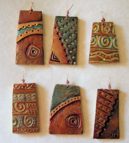 Polymer clay pendants. You can use black clay and add powder color before baking. Or paint them afterward.