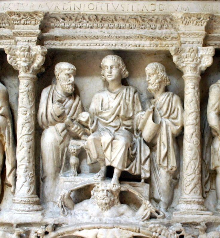 Sarcofago di Giunio Basso: particolare. La traditio legis. Dal punto di vista icononografico, si vede qui rappresentato il gesù apollineo, giovane fanciullo imberbe ammantato di toga.
