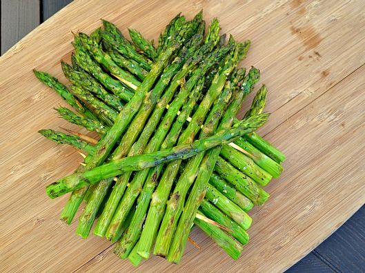 Grilled asparagus with olive oil and sea salt. Use bamboo skewers