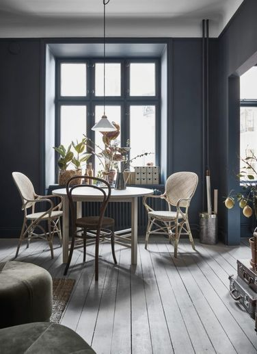 Wicker and Wood in A Tiny Stockholm Apartment Painted Blue