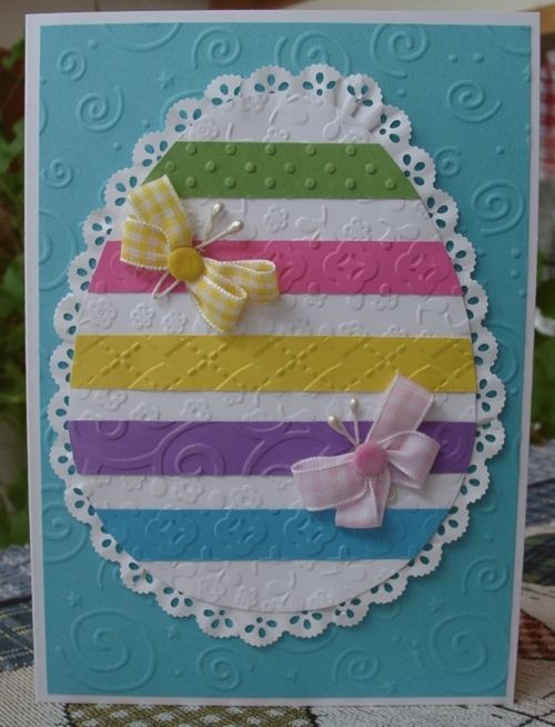 Sue Nelson/Heartprints.net.  Love the ribbon butterflies!  I will eliminate the lace trim and make the egg decoration with varied shapes.