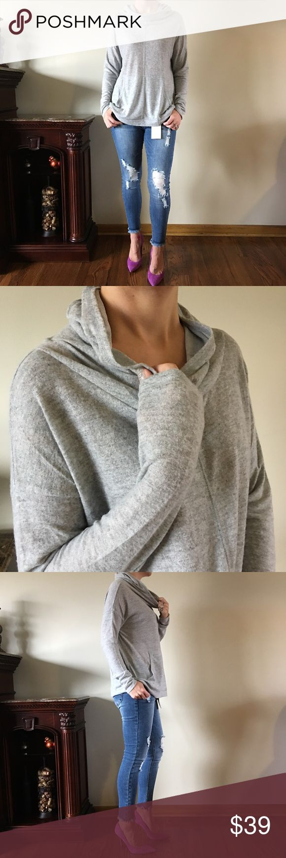 """Cowl Neck Hoodie This cowl neck hoodie in heather gray, seriously makes you feel like you are wrapped in a cozy blanket..super soft and comfy without being bulky..kangaroo pocket in front..great for everyday & running errands!  💕I'm 5'7"""" modeling the Small 💕Rayon/Polyester 💕Pit to Pit: S-22"""" M-23"""" L-24"""" 💕Length Shoulder to Hem: S&M:~25""""  L:~26"""" Tops Sweatshirts & Hoodies"""