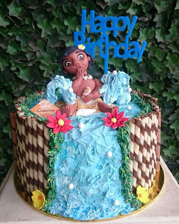 """I am Moana from Montunui, the Ocean Choose Me for a Reason""- Moana.  A customized Moana Disney Cake. Layers of Chocolate Oreo Cake, covered in Chocolate Wafer sticks with Handmade Moana Fondant Doll, and beautiful Buttercream Waterfall."