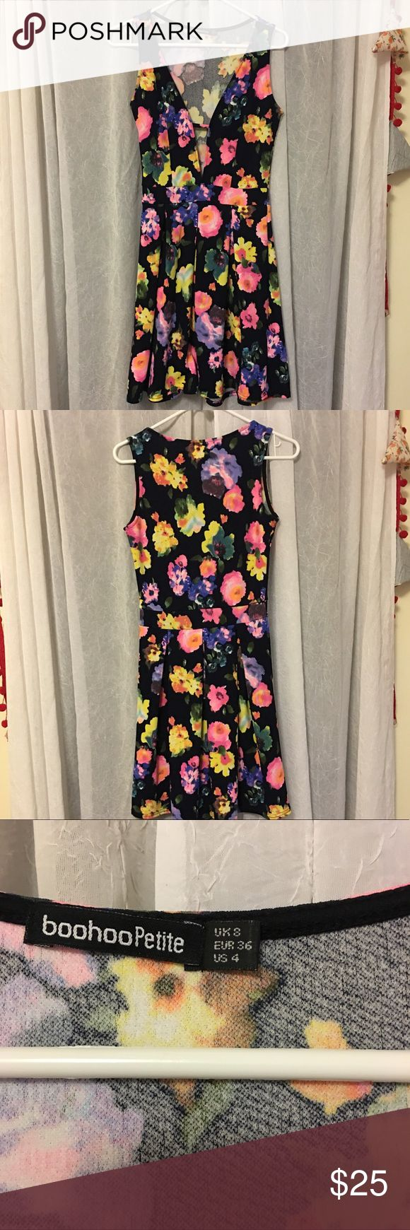 Floral Cut Out dress! 🌺 NWOT 🌸 Boohoo US size 4 Adorable dress with front cut out, pink yellow orange blue and purple flower pattern! From boohoo petite size 4 never worn (just tried on) hits just above the knee. This pattern reminds me of spring and weekend brunches! Perfect for any occasion. 34.5 inches from shoulder, waist is 25 inches. The fabric has stretch! Boohoo Petite Dresses