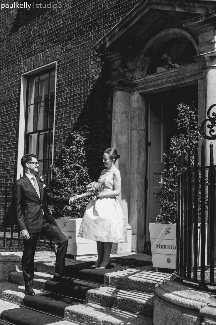 Bride and groom posing outside the elegant @themerrionhotel .Dublin wedding venue. Wedding photography by PK Studio3.