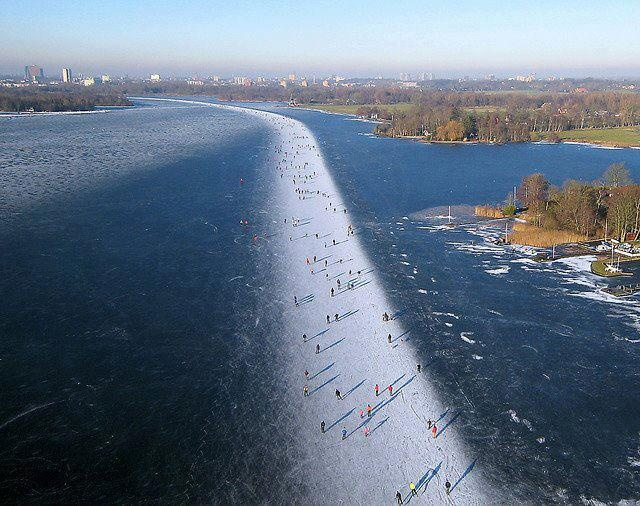 Walk on the ice with water on your both sides.at- Paterswoldsemeer, Dutch city of Groningen.