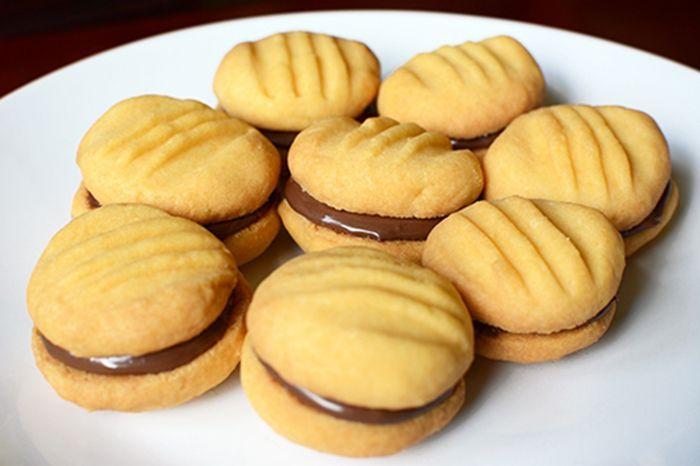 Galletas de Mantequilla Rellenas de Chocolate Te enseñamos a cocinar recetas fáciles cómo la receta de Galletas de Mantequilla Rellenas de Chocolate y muchas otras recetas de cocina..
