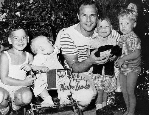 Marlon Brando poses with a group of children, 1956 #Brando