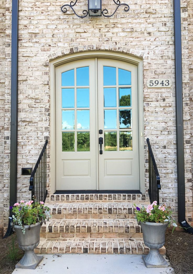 French Provincial home with Oyster Pearl Brick and Light Buff Mortar. Nice entryway.
