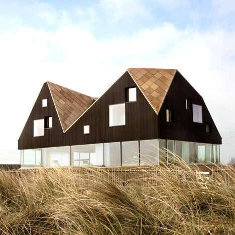 The third completed house in Alain de Botton's Living Architecture series has a faceted black upper storey that sits on top of the glass-walled ground floor like a big hat.