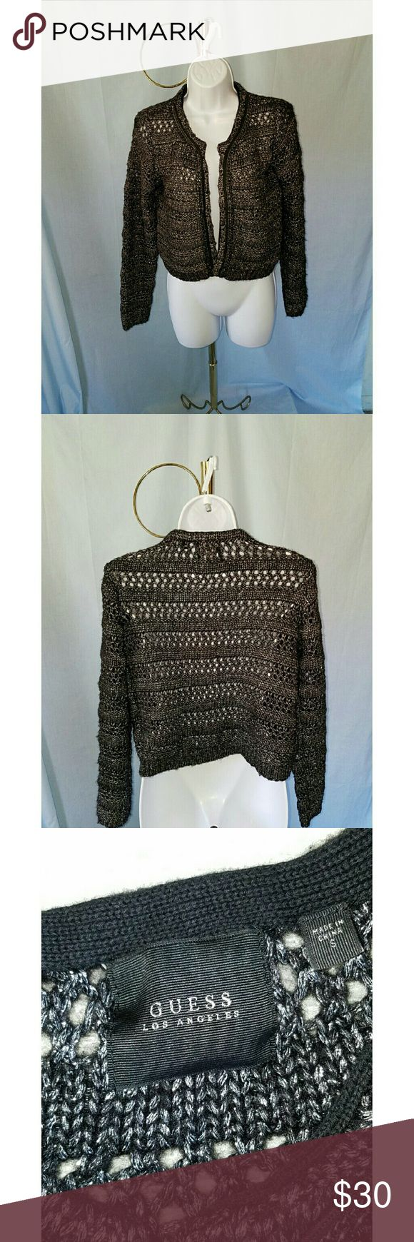 """GUESS BLACK AND METALLIC SILVER CARDIGAN GUESS BLACK AND METALLIC SILVER CROP CARDIGAN  has an open front with chain trim around the neckline and sweater opening. It has an open front. Size S  29%polyester 26% acrylic 26% wool and 19% metallic.  Armpit to armpit is 18.75"""" and shoulder to hem is 18.5"""". All measurements are approximate and taken flat. Guess Jackets & Coats"""