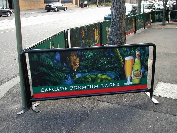 Outdoor cafe barriers on pavement.