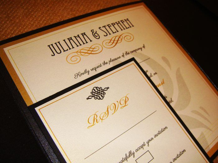 Black pearlescent pocketfold invitations with gold backing paper and ivory inserts. Art Deco-style, perfect for a sophisticated affair! Includes RSVP card and envelope.  www.justaddyou.ie