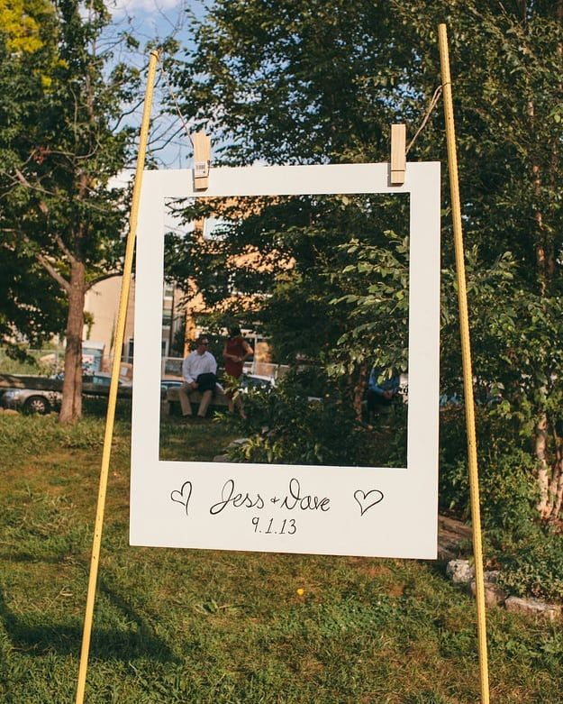 Simply cute polariod frame at this outdoor wedding booth