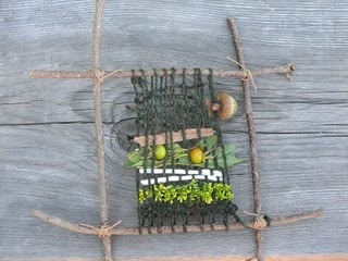 Stick weaving, with natural materials.