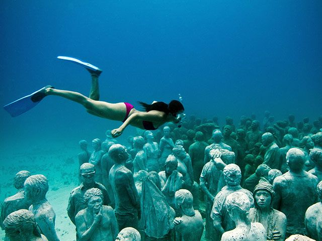 Underwater Museum / Cancun, Mexico. More than 400 life-sized sculptures are made from pH neutral clay in order to promote the growth of coral reef and marine life.Cancun Mexico, Coral Reef, Sculpture Gardens, Underwater Museums, Scubas Diving, Cancunmexico, Underwater Art, Isla Mujeres, Weeping Angels