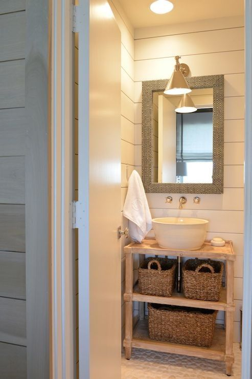 Munger Interiors - bathrooms - Boston Functional Library Wall Light, diamond fabric wrapped mirror, library wall light, round bowl sink, wall mounted faucet, pebble floor, tongue and groove walls.