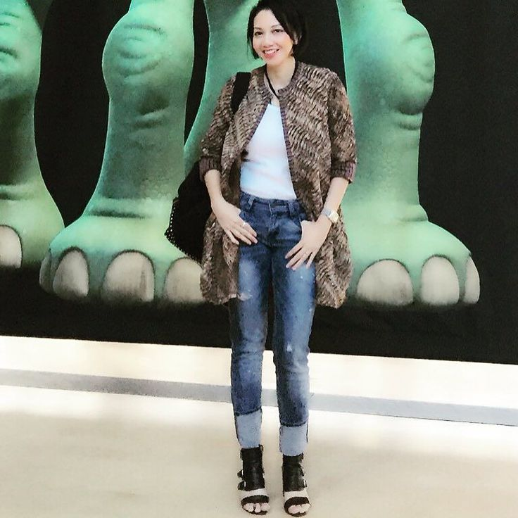 Batik jacket by Yani Soemali with backdrop of Good Dinosaur legs at PIXAR HQ  #batikindonesia #batik #pixar by shintabubu