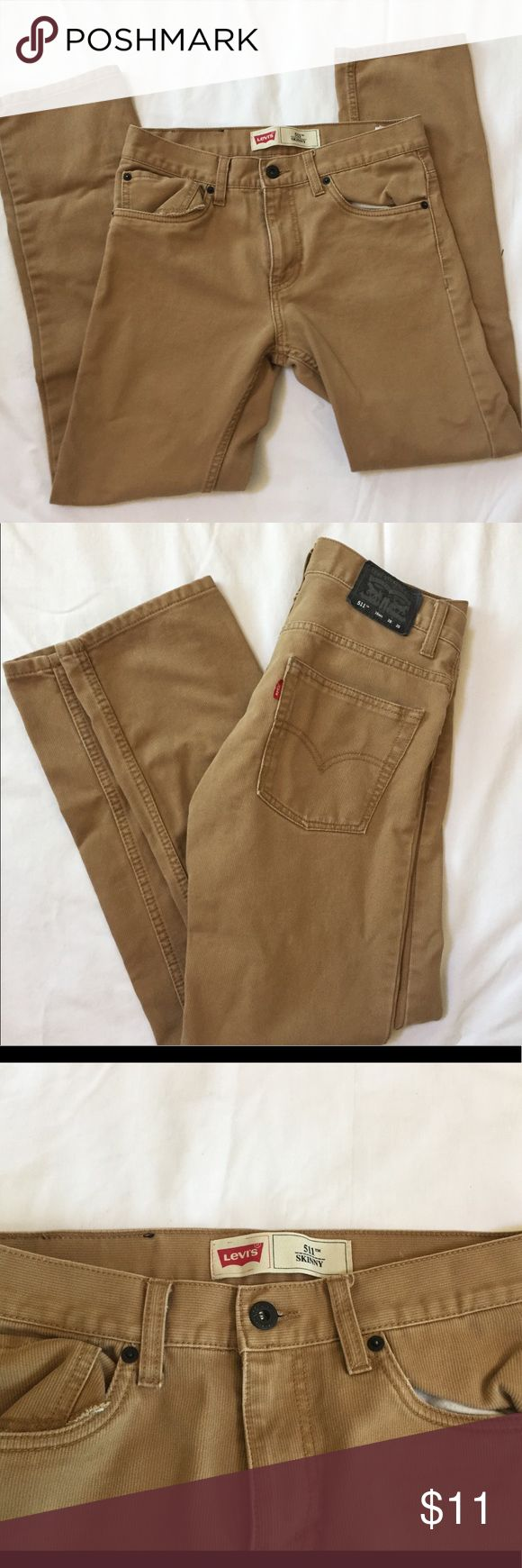 "Girl's Levi's 511 Skinny Fit Tan pants 28 x 28 Item: Kids Girls Levi's 511 Skinny light brown pants.   Measurements:  Size on Tag: 16 Regular Inseam: 28"" Waist: 28""  Condition: In overall great shape.   A few details:  -Back Levi's tag peeling off a little -Otherwise in near new shape, no other signs of wear or tear, bottom of the pant legs intact and show no signs of scuffing or wear.   All my items are from a smoke free environment. Levi's Bottoms Casual"
