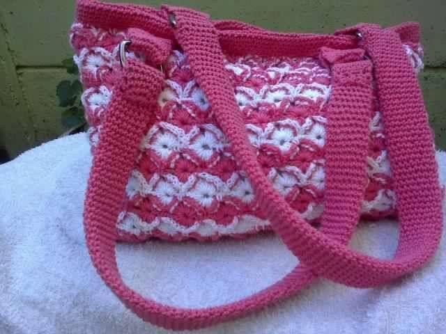cartera rosada con blanco, $6000