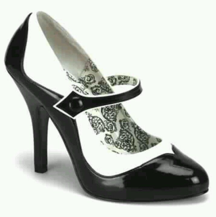 """Take your classic Mary Jane to a new level with this adorable 4 1/2"""" two tone Mary Jane pump with elastic strap, button detail and contrast piping, and 1/2"""" concealed platform. Size: 7. Color: Black."""