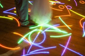 Glow sticks are great for an exit at the end of the wedding day or a colorful prop on the dance floor like at this wedding at the Water Table in Virginia Beach by Heather Hughes Photography. #glowsticks #thewatertable #hhpva #virginiabeachphotographer