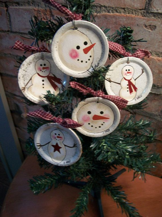 CaneBottomCrafts..Hand Painted Snowman Ornaments On Canning Jar Lids...These are jar lids that fit a regular mouth mason jar. I have painted and sealed with an indoor/outdoor clear coat, added a wire for hanging and tied with homespun.