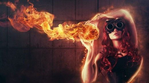 Sexy Redhead Woman Playing with Fire