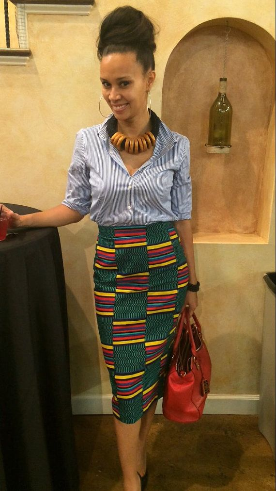 Pencil skirt. Cotton. Kente print. Lining. Back zipper.  Size XS (US S 0-2) WAIST: 26-27 HIPS: 36 - 38 Size S (US S 4-6) WAIST: 28 - 29 HIPS: 39 - 41