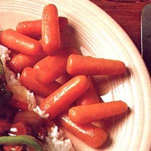 Glazed Baby Carrots Recipe -For an extra zip for a carrot side dish, try this recipe. These brown sugar carrots come together in no time at all.—Anita Foster, Fairmount, Georgia