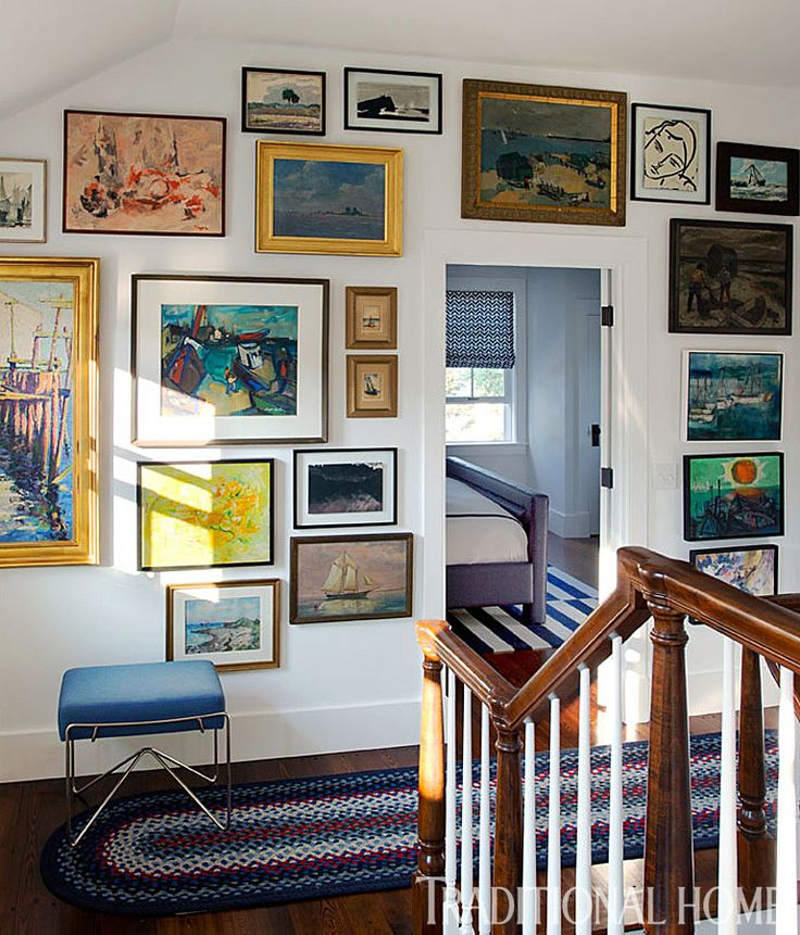 Original paintings from regional artists grace the walls in the upper hallway. - Photo: Eric Roth / Design: George Nunno and Jon Maroto