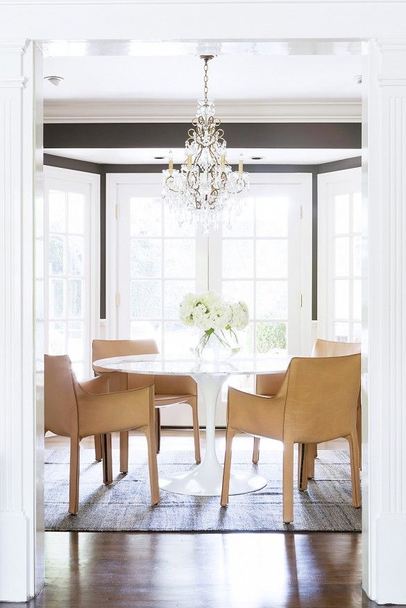 7 Essentials for a Beautiful Dining Space// leather dining chairs with a modern table and crystal chandelier