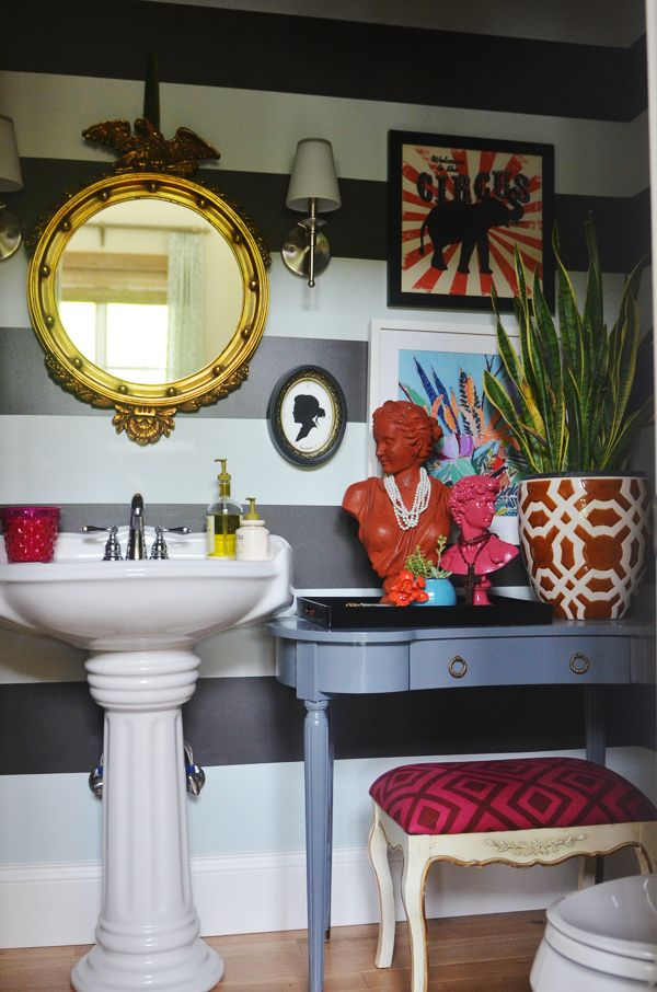 love this bathroom make over with all the quirky details and funky colors but neutral walls.