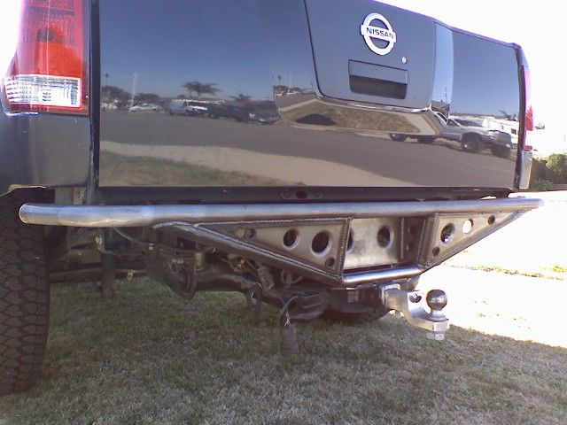 """Prerunner type bumper. I would like to have BudBuilt design and build a bumper similar to this with 2 LED lights recessed, 2"""" receiver, 2 recovery points, as well as work in a CR type tiregate with my backup camera in the spare tire center."""