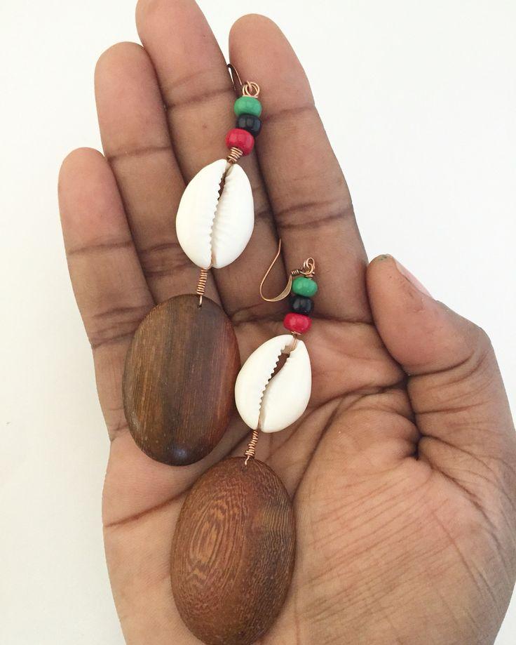 Wood, cowry shell, and seed bead earrings.