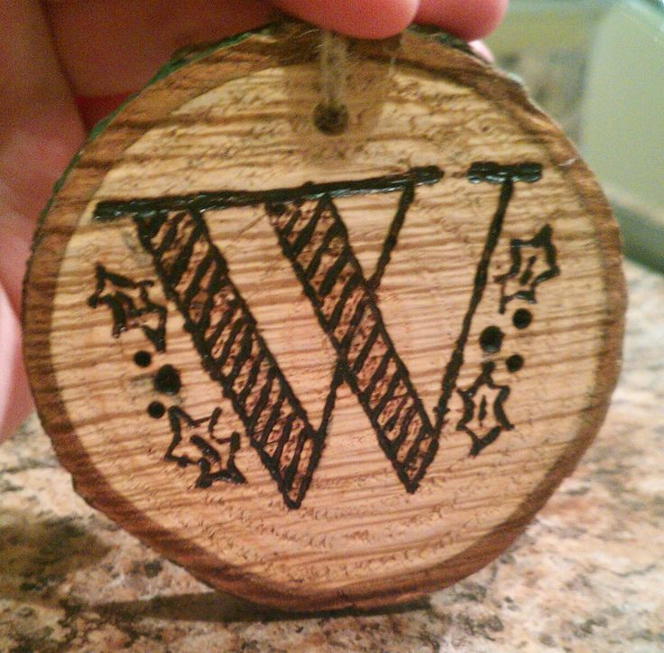 Wood burned Christmas ornaments and wreaths