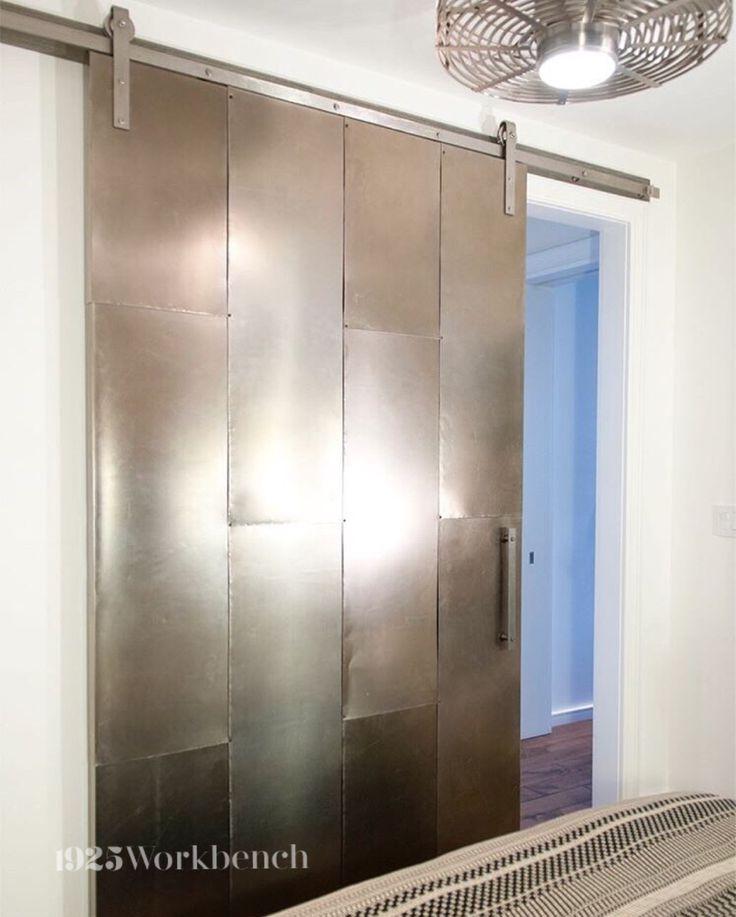 Metal sliding door on our stainless steel barn door hardware. Made in Canada. #barndoorhardware #metaldoor