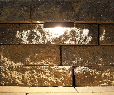 The Nox Lighting LED Retaining Wall Light is designed to be installed under retaining wall caps or stair treads.
