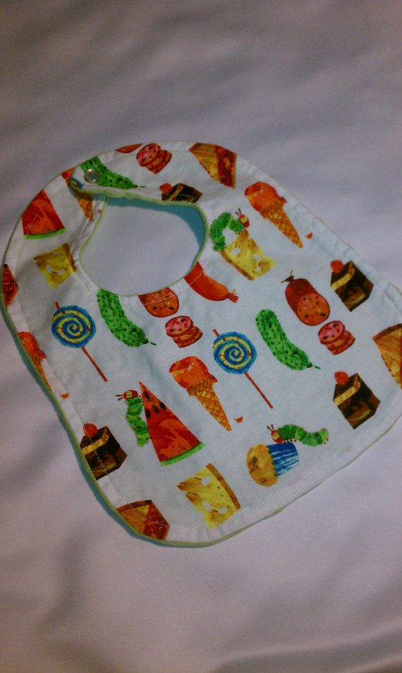 Perfect for feeding time! This cute Hungry Caterpillar bib will look so adorable on your little one! It is backed with soft light green minky