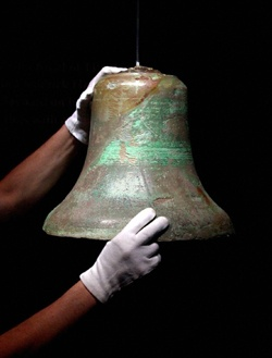 """This bell is from the Titanic, and was raised from the ocean floor.  The Titanic bell rang when lookout Frederick Fleet shouted,  """"Iceberg right ahead!"""""""