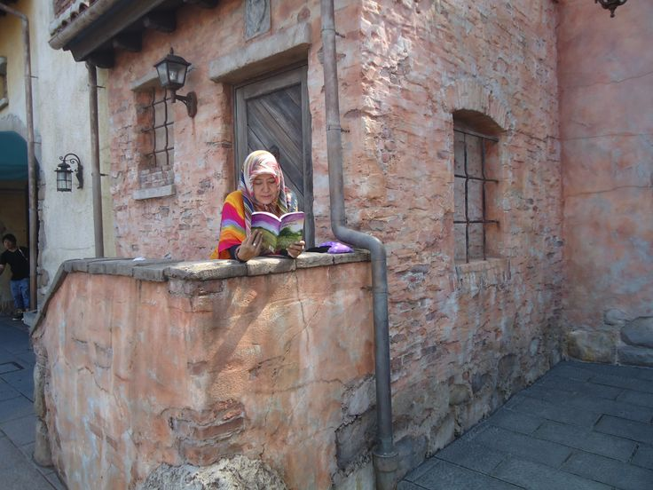 "When me reading my book ""Dandelion dalam Rindu"" on the Disney Sea World Tokyo"
