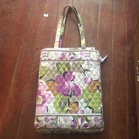 Vera Bradley travel bag Gently used travel bag! Hold your laptop or whatever devices you may want to use. I used it for traveling when I had my internship. Worked great as a carry on, multiple compartments and keeps my items safe. Vera Bradley Bags Travel Bags