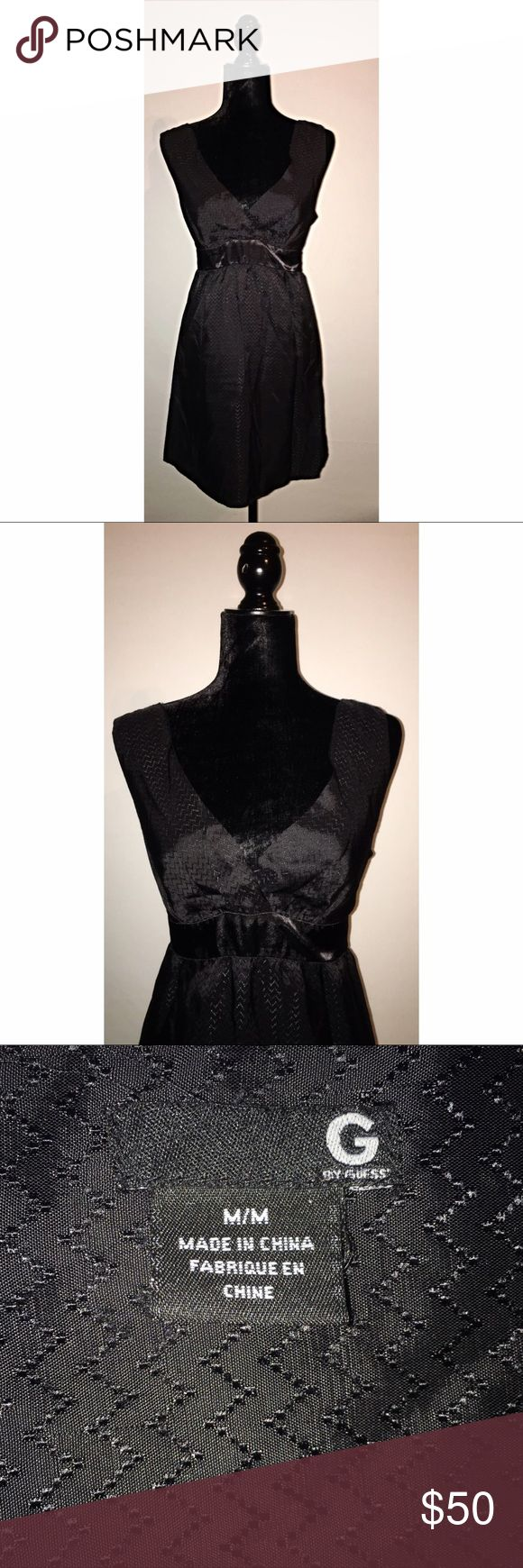 GUESS BLACK LOW V-NECK BLACK DRESS WITH BLACK BOW TIE IN BACK.  THERE IS A SNAG ON THE ZIPPER BUT NOTHING THAT CAN'T BE FIXED THAT THE BOW WONT COVER Guess Dresses #NothingButDresses